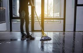 cleaning floor with mop before sweeping